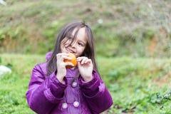 Child on Orange Farm Peeling the Fruit Stock Photography