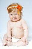 Child with orange frontlet on her head Royalty Free Stock Photo