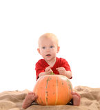 Child with orange pumpkin Royalty Free Stock Photo
