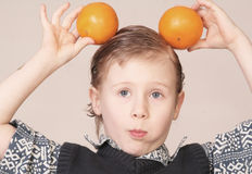 Child with oranges. Little blond boy with some oranges stock photo