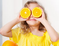 Child with oranges Stock Photo