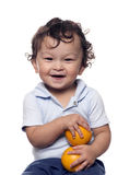 The child with oranges. Stock Photos