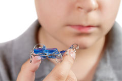 Child with orthodontic appliance. Boy holds an orthodontic appliance in his hand Stock Image