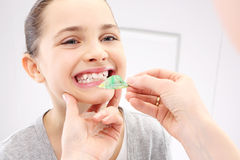 Child with orthodontic appliance. Portrait of a little girl with orthodontic appliance Stock Photography