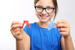 Child with orthodontic appliance. Pretty girl with colored orthodontic appliance Stock Images