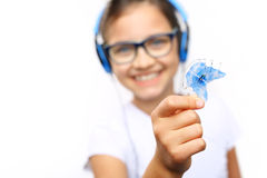 Child with orthodontic appliance. Pretty girl with colored orthodontic appliance Stock Image