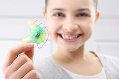 Child orthodontist. Portrait of a little girl with orthodontic appliance Royalty Free Stock Photo