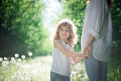 Child outdoor with her mother Royalty Free Stock Photography