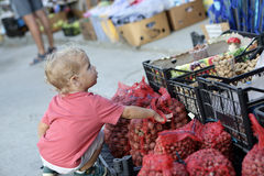 Child at outdoor market. Portrait of child at an outdoor market Royalty Free Stock Image