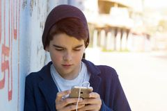 Child with mobile. Child with outdoor mobile phone Stock Photo