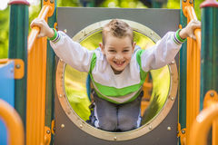 A child on outdoor playground Stock Photos