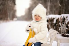 Child, outdoor playing, white, snowy winter in the forest. stock image