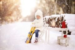 Child, outdoor playing, white, snowy winter in the forest. stock photos