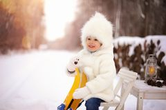 Child, outdoor playing, white, snowy winter in the forest. royalty free stock image