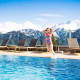 Child in outdoor swimming pool of alpine resort Stock Photos