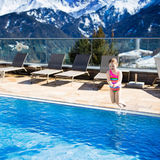 Child in outdoor swimming pool of alpine resort Royalty Free Stock Photos