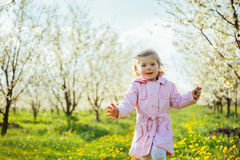 Child outdoors in the blossom trees. Art processing and retouchi Royalty Free Stock Photos