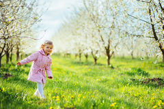 Child outdoors in the blossom trees. Art processing and retouchi Stock Photo