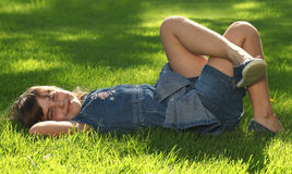 Child Outdoors in the Grass Stock Photography