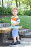 Child Outdoors Hot Summer Spring Day, Hydrating. Child outdoors in a park in summer, active and fit, thirsty drinking a juice Royalty Free Stock Images