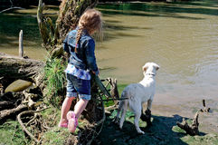 child outdoors in nature with dog Royalty Free Stock Photography