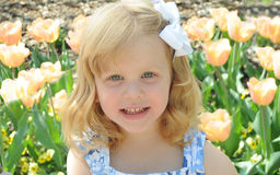 Child outside. A beautiful child outside smiling in sunny weather Royalty Free Stock Image