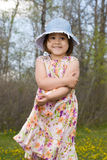 Child Outside Wearing Summer Dress. Four year old girl smiling, while wearing a summer dress and enjoying the outside air Stock Images