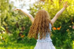 Child outstretched arms enjoying fresh air. Child outstretched arms enjoying fresh air and sunlight Royalty Free Stock Photo