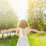 Child outstretched arms enjoying fresh air and sunlight. Instagram filter. Soft focus Stock Photography