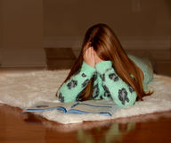 Child overwhelmed by her homework. Royalty Free Stock Images