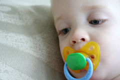 Child with Pacifier Stock Images