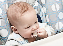 A child with a pacifier Stock Photography