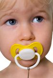 Child with Pacifier in Mouth Stock Photo