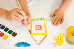 Child with paint. Royalty Free Stock Photo