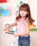 Child with paint  in art class . Royalty Free Stock Photo