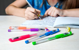 Child paint a coloring book. Coloing pens on table. Selective focus. Stock Images