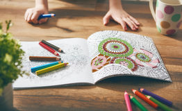 Child paint a coloring book Royalty Free Stock Photography