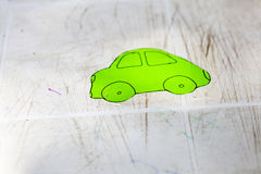 Child paint. Green car painted by child stock photos
