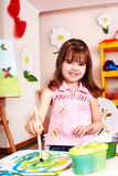 Child paint picture in preschool. stock photography