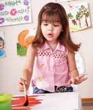 Child paint picture in preschool. Stock Image