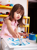 Child paint picture in preschool. Royalty Free Stock Photo