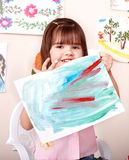 Child paint picture in preschool. Royalty Free Stock Photos