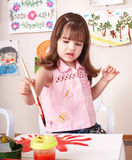 Child paint picture in preschool. Stock Photos