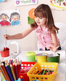 Child paint picture in preschool. Stock Images