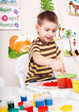 Child paint picture in preschool. Royalty Free Stock Photography