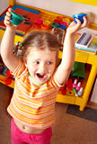 Child with paint  in play room. Royalty Free Stock Image