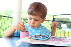 Child with paintbrush Stock Images