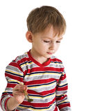 Child with paintbrush Stock Photo