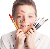Child with paintbrush. Boy paint isolated on white stock image