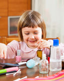 Child  painted cosmetics Royalty Free Stock Photo